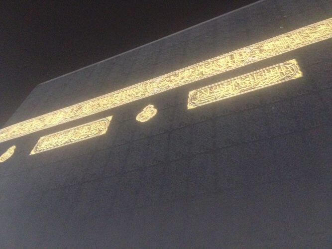 One side of the Holy Kaba with black cloth and gold banners